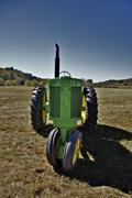green farm tractor - stock photo