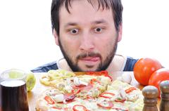 Adult person with surprised face on pizza table Stock Photos