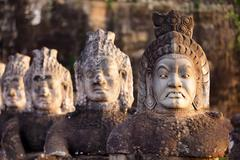 angkor south door statues - stock photo