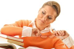 young woman reading a book. female student learning - stock photo