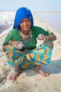 indian female worker on salt farm - stock photo