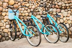 Three old, rusty blue bicycles Stock Photos
