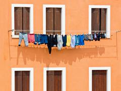 windows with washing hung on drying - stock photo