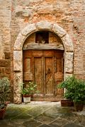 old door in of brick building .. - stock photo