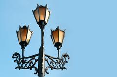 Antique metal street lamp Stock Photos