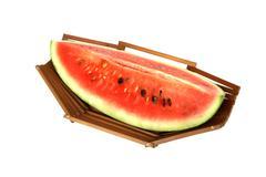 Watermelon slice in bamboo fruit basket Stock Photos