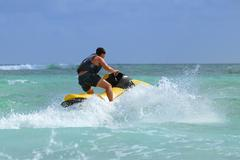 Man drive on the jetski Stock Photos