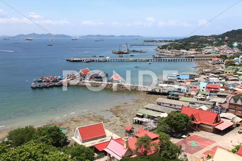 Stock photo of aerial view fisherman village pier