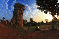 silhouette of mor hin khao, thailand stonehenge, with beautiful sunrise - stock photo
