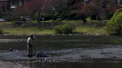 Japanese Fisherman In Nishiki River Stock Footage