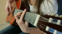 Young Girl Playing Guitar Stock Footage