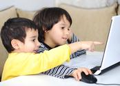Stock Photo of childhood, laptop, learning and playing