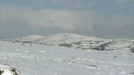 Stock Video Footage of Pan of snow covered Dartmoor hills overlooking widecombe