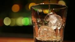 Tracking shot of serving whiskey - stock footage