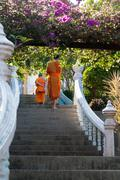 two buddhist monks in monastery - stock photo