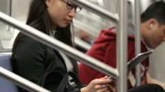 Woman Using Tablet Device on Subway - Voyeuristic Shot Stock Footage