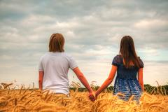 Couple staying at a wheat field Stock Photos