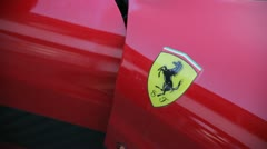 Ferrari logo on a red ferrari - stock footage