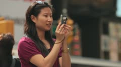 Woman Taking Photos of Busy Timesquare Stock Footage