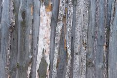 unpainted rough wooden wall - stock photo