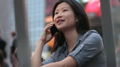 Woman Talking on Cell in Timesquare Flashing Signs Stock Footage