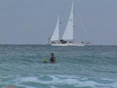 Sailboat and Surfer - stock footage