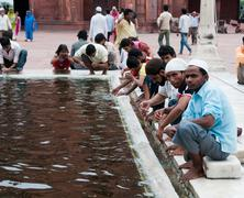 ablution in jama masjid, india's largest mosque - stock photo