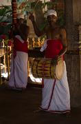 traditional ceremonial drummer in buddhist temple - stock photo