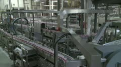 STOCK VIDEO FACTORY ROBOTIC ASSEMBLY AUTOMATED LINE BEVERAGE FACTORY HD 1080 - stock footage