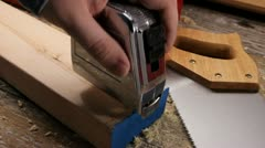 Measuring 2 x 4's with a tape measure Stock Footage
