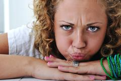 teen girl with angry grimace - stock photo