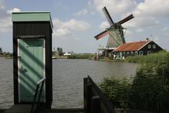 Outhouse and windmill - stock photo