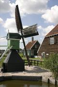 Small windmill on farm - stock photo