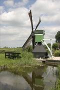 Canal wind pump - stock photo
