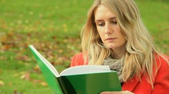 Caucasian student autumn day revising Stock Footage