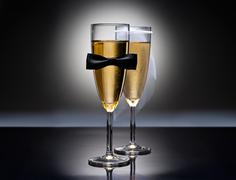 champagne glasses with conceptual heterosexual decoration - stock photo