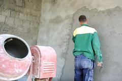 Construction worker doing his job with agitator Stock Photos