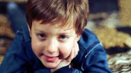 Stock Video Footage of portrait happy child smiling at camera