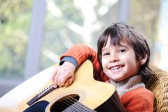 my son playing guitar at home - stock photo