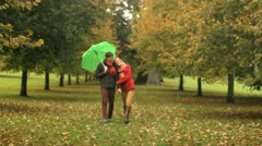 People taking cover from climate in Autumn Stock Footage