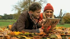 Caucasian people having fun on wireless tablet  - stock footage