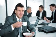 Stock Photo of businessman in business ambience drinking cofee