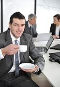 businessman in business ambience drinking cofee - stock photo