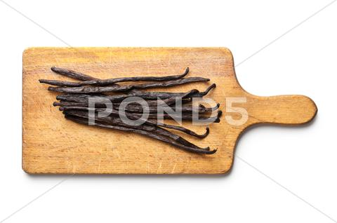 Stock photo of vanilla pods on chopping board