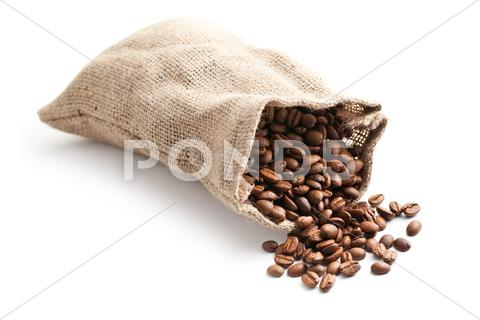 Stock photo of coffee beans in jute bag