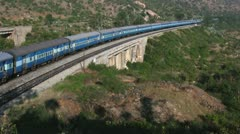 An Express train speeds through Makalidurga station near Bangalore India. Stock Footage