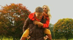 Fun and laughter in the park in the Fall - stock footage