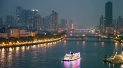 Traffic on quay and bridges over Pearl river with boats Stock Footage