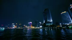 Touristic vessel sail by Pearl river with skyscraper on shore Stock Footage