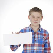 boy standing with empty horizontal blank in hand - stock photo